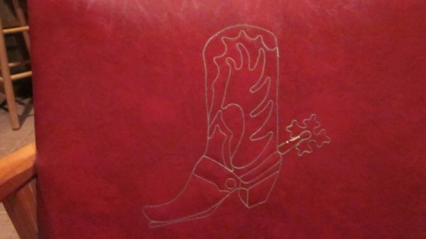 Stitched boot on the red wagon wheel side chair