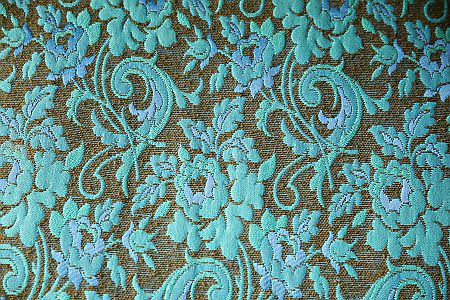 close up of turquoise brocade fabric