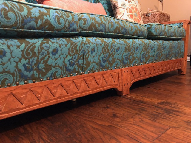 closeup of carved wood detail on bottom front of sofa