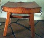 A BRANDT RANCH OAK LEATHER STOOL - IN NM