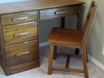 A BRANDT RANCH OAK STUDENT DESK AND CHAIR-IN AZ