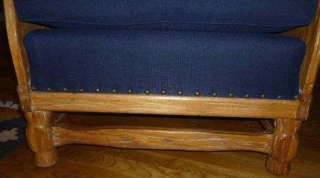 Bottom Front of the wing chair with nail head trim