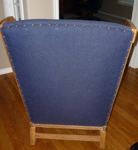 Back side of wing chair with nail head trim