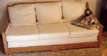 Picture of the whole couch reupholstered in white Naugahyde.  The back cushions are down filled.