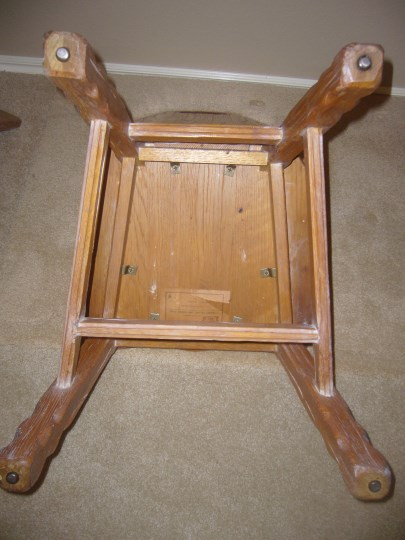 BOTTOM OF CHAIR ONE WITH ORIGINAL METAL GUIDES