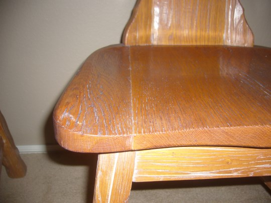 CLOSEUP OF SLIGHT SEPARATION GAP ON CHAIR SEAT OF CHAIR TWO