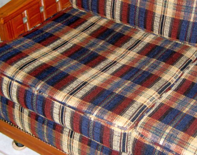 CLOSEUP OF PLAID FABRIC WITH DARK BLUE, DARK RED AND TAN